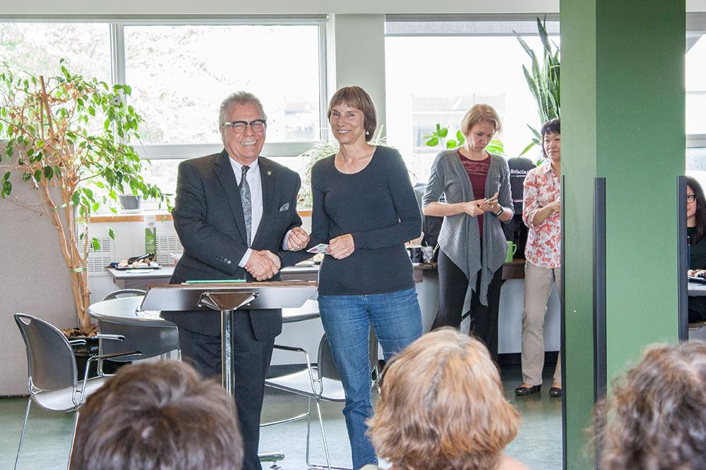 Dean Blye Frank congratulates Alex Allen, ECPS, honouree for the Dean's Award of Staff Excellence.